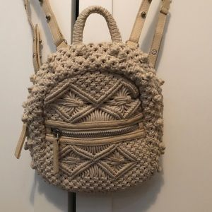 Crochet mini backpack with adjustable straps